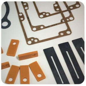 A collection of rounded edge, multicolored, custom gaskets produced by Accurate Felt & Gasket
