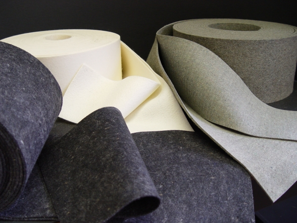 Rolls of felt in different colors, gray, cream, and black, from Accurate Felt